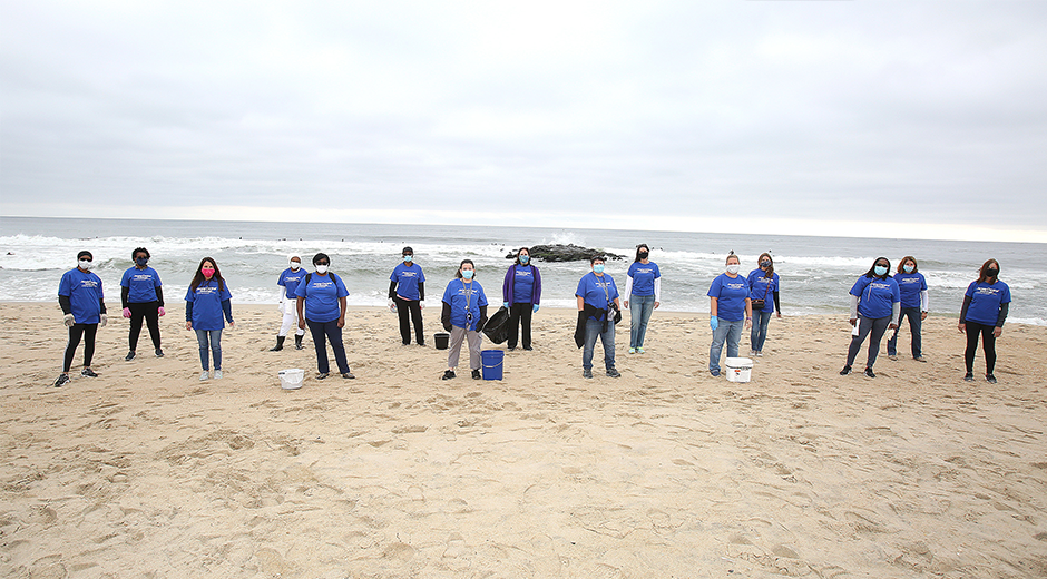 JCP&L employees sweeping beach