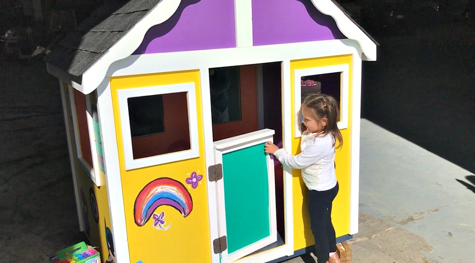 child entering a playhouse