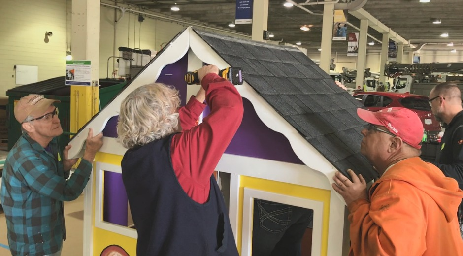 toledo edison employees building a playhouse