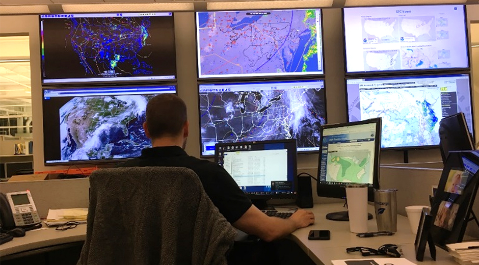 FirstEnergy meteorologist monitor the weater on several large screens.